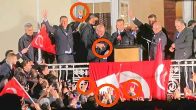 Türkischer Aussenminister Oglu zeigt Graue Wölfe-Gruß